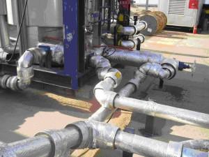 Чугунная задвижка в трубопроводной системе